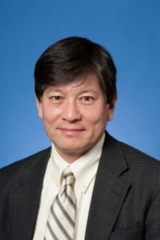 Professor Mike Mochizuki, pictured in professional attire