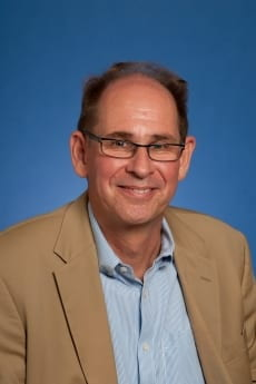 Professor Robert J. Sherman, pictured in professional attire