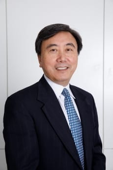 Professor Liang (Larry) Yu, pictured in professional attire