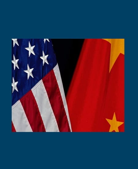 The flags of China and the United States stand displayed next to each other
