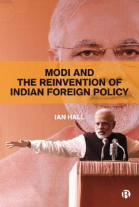 Orange cover with superimposed images of Indian Prime Minister Narendra Modi