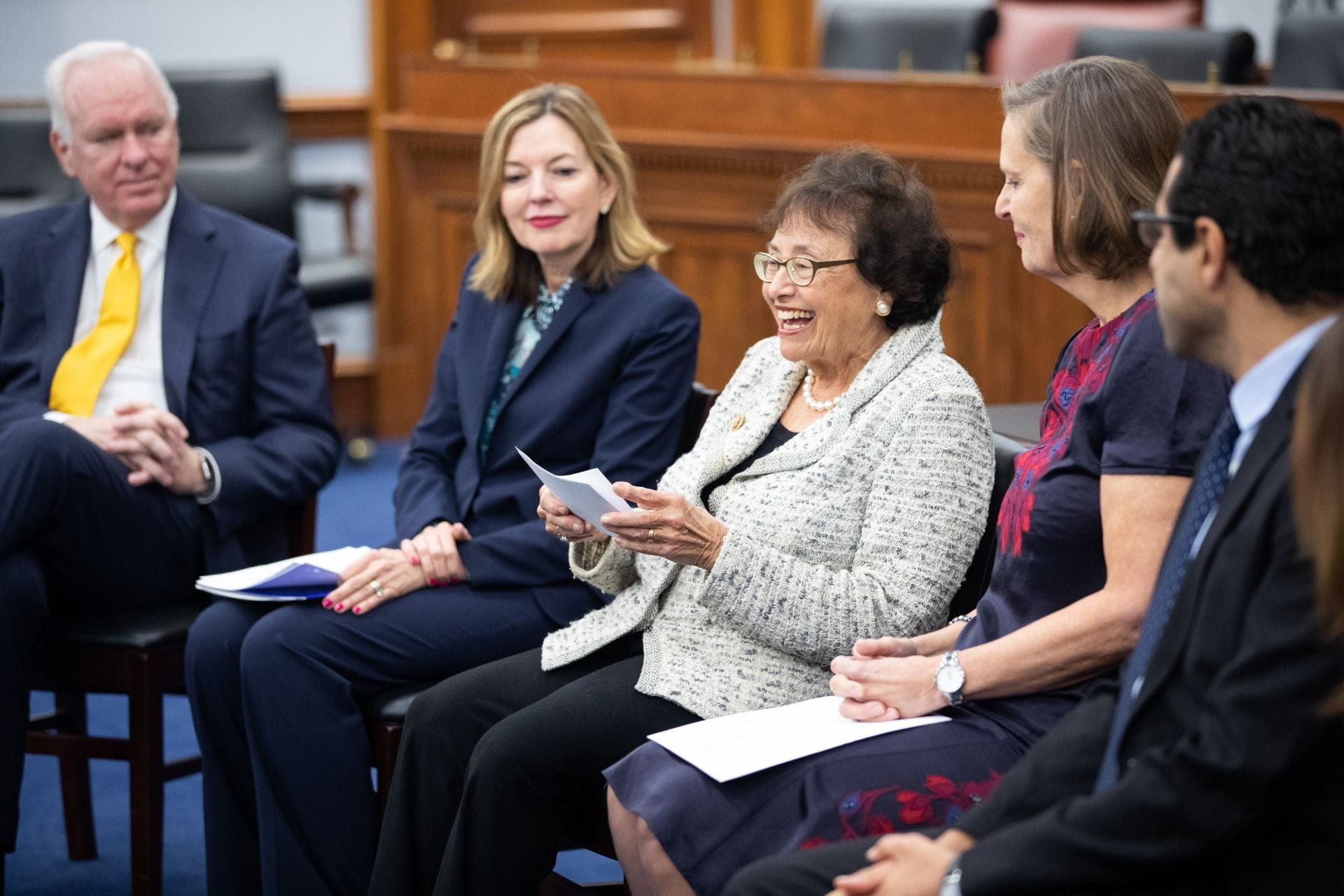 Nita Lowey speaking at her award ceremony with four others sitting beside her