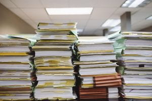 Stacks of files and paperwork.