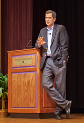 David Pogue, keynote speaker, casually leaning on the podium at Union Forum Hall (photo by Eric Dover)