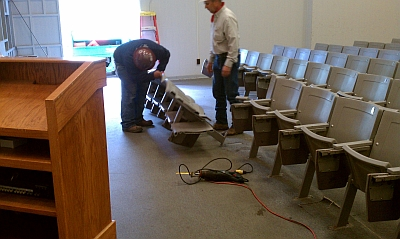 photo of chairs being removed from Umberger 105 classroom due to summer renovation