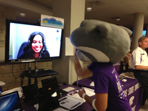 An IT Help Desk consultant videoconferences with Willie the Wildcat during 2013 Orientation and Enrollment