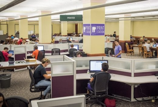 Dozens of students on the second floor of Hale Library study and use the computers and printers.