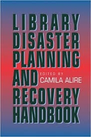 A red book cover that reads Library Disaster Planning and Recovery.