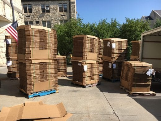 Boxes on pallets arrive at Hale Library