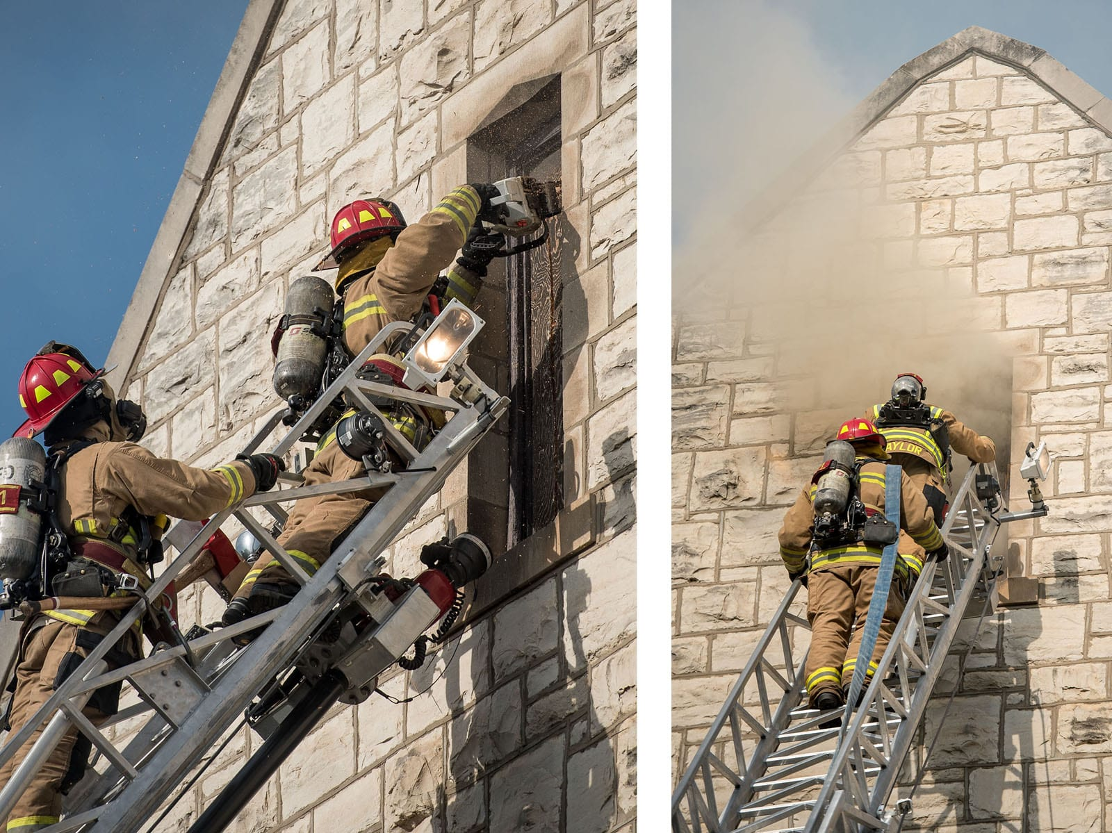 Two firefighters in full protective gear and oxygen masks stand at the top of a metal extension ladder while accessing a small window in the peak of a limestone building.