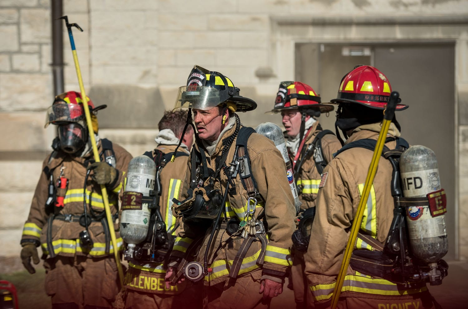 Five firefighters in full gear on the scene of the Hale Library fire.