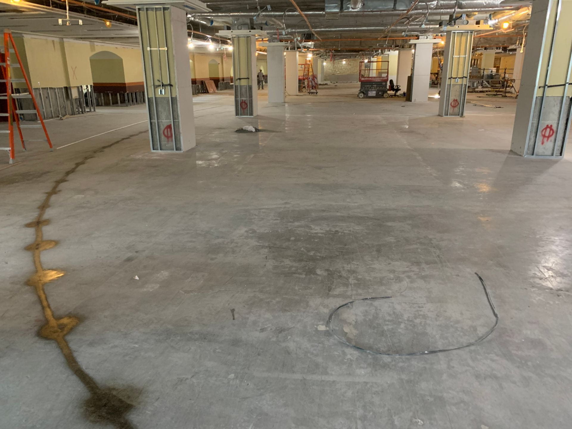 A line on the concrete floor depicts the location for a new classroom.