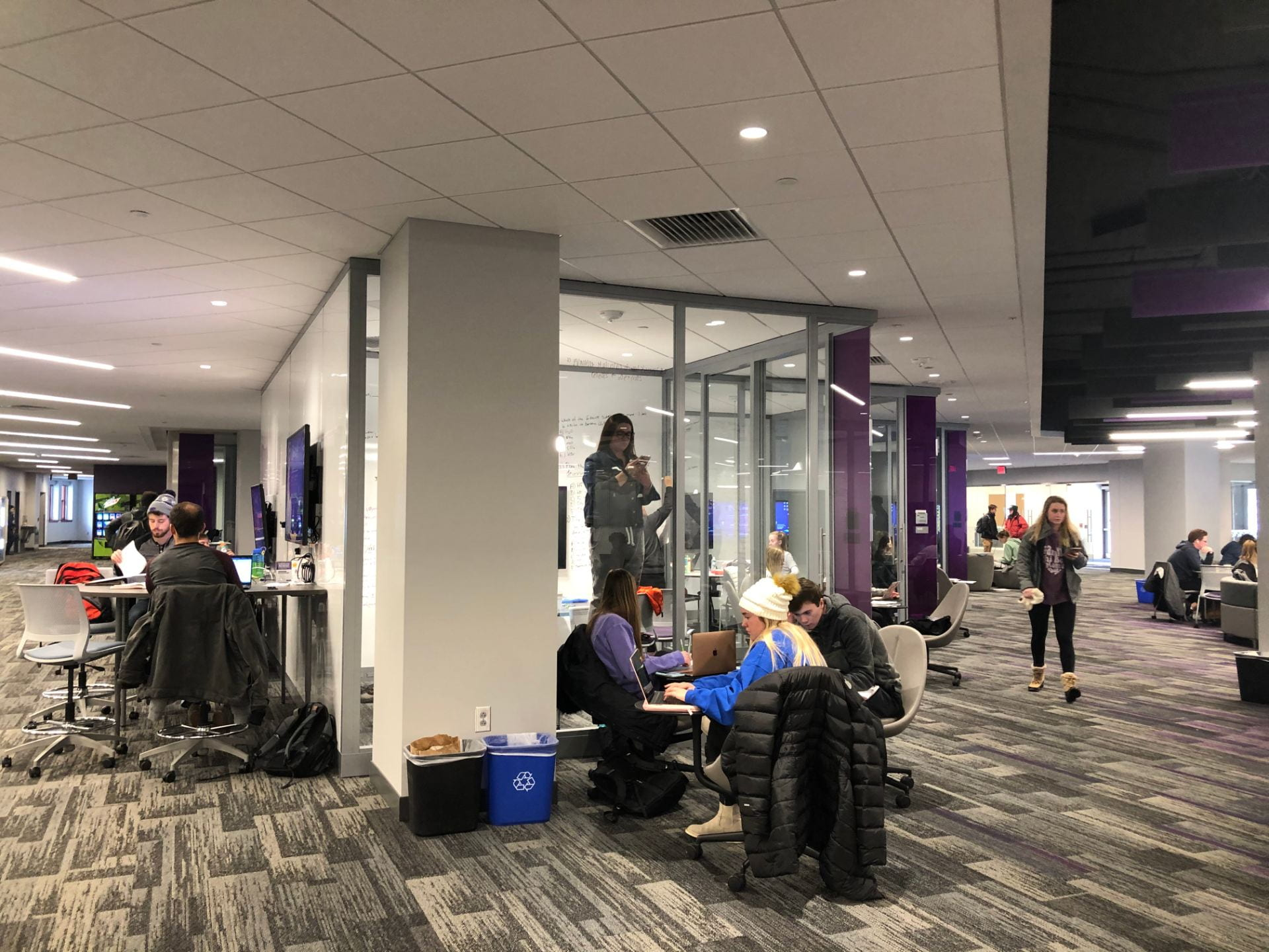 The first floor of Hale Library is packed with students studying.