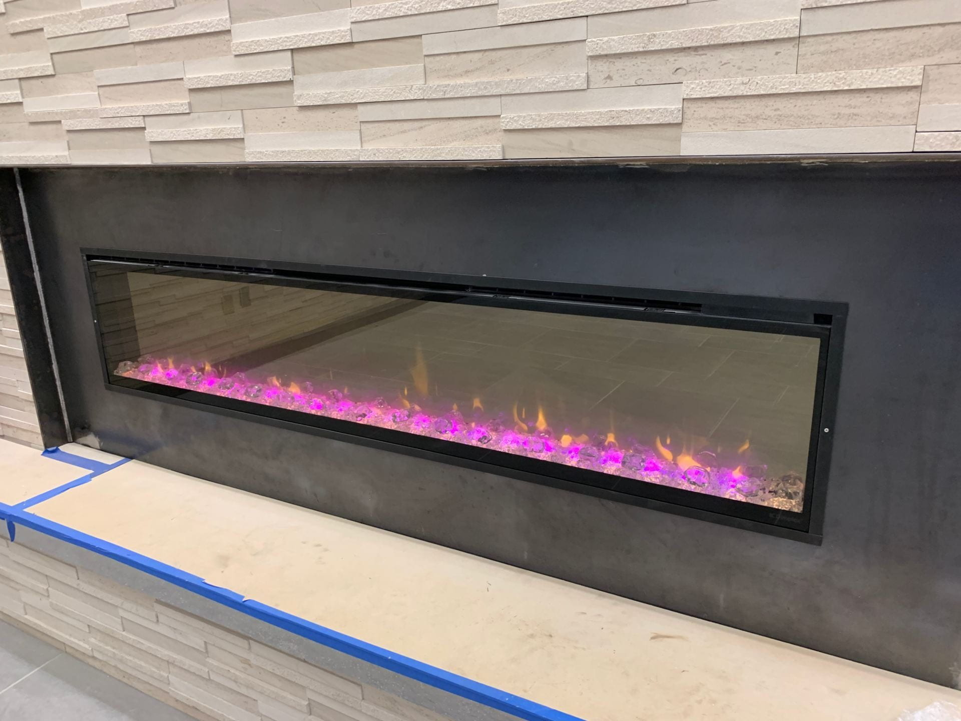 A picture of the fireplace inside the cafe.