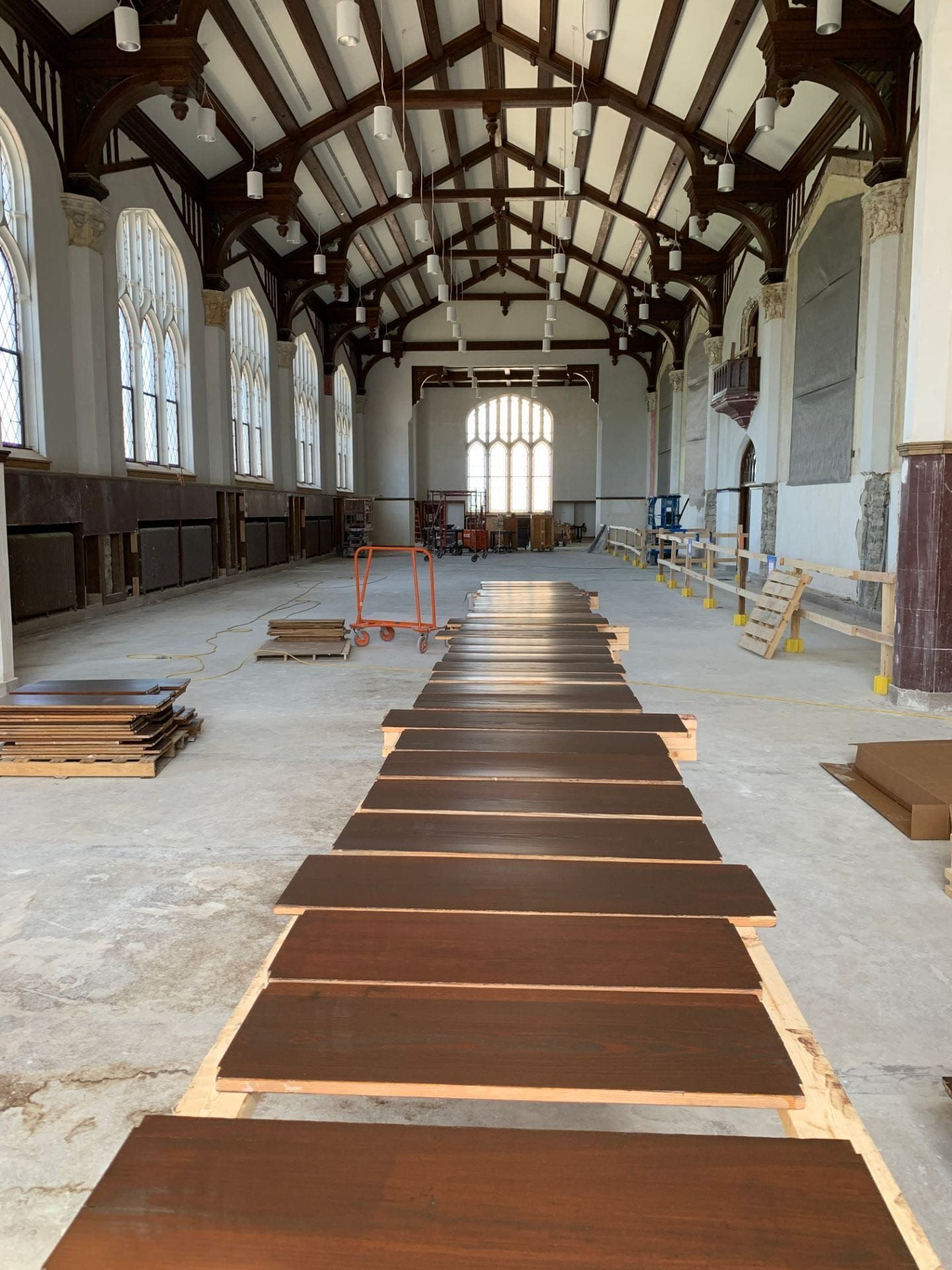 A picture of varnished wood laid out along the length of the Great Room.