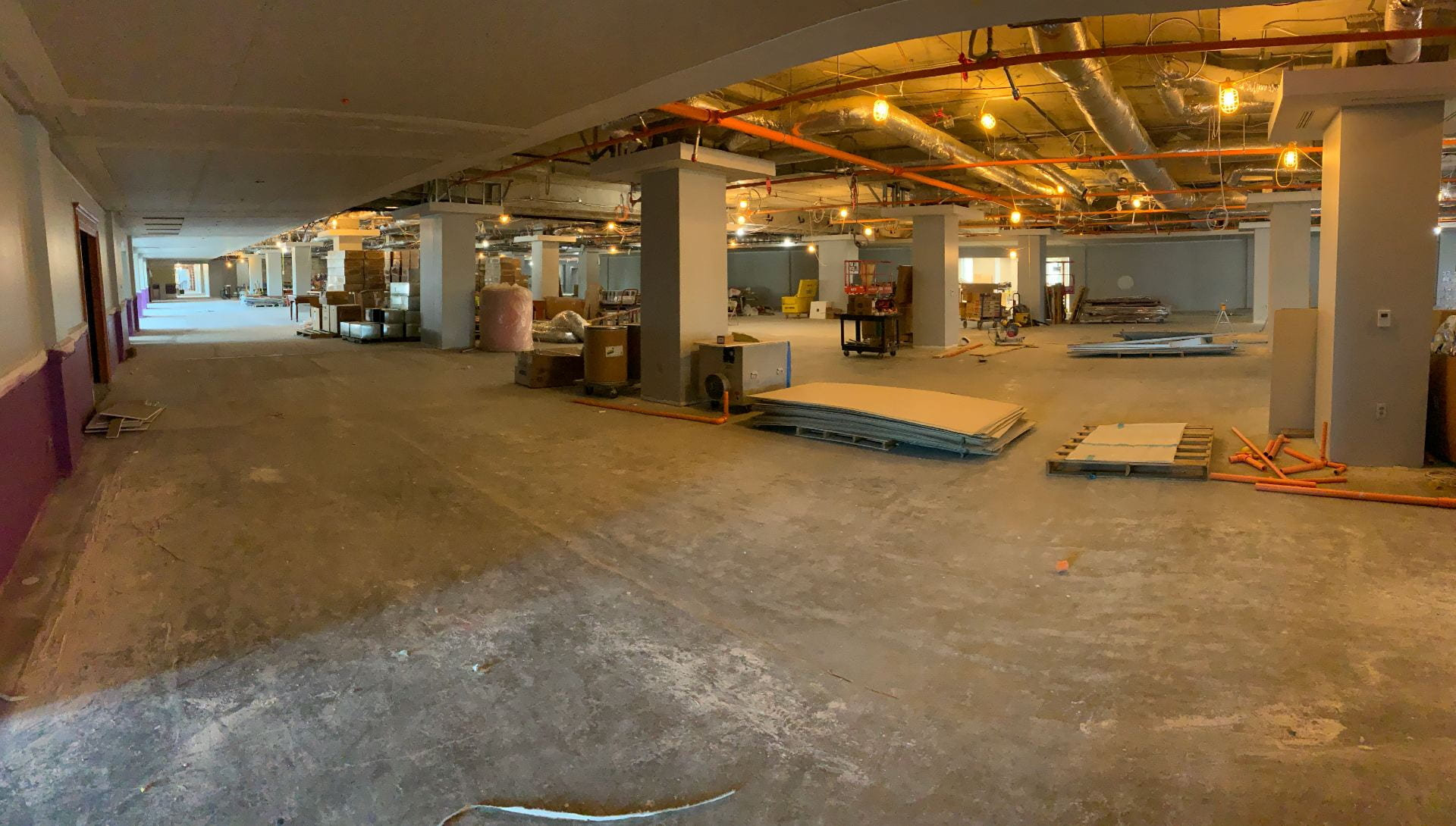 A picture of the fourth floor, still under heavy construction with dim lighting.