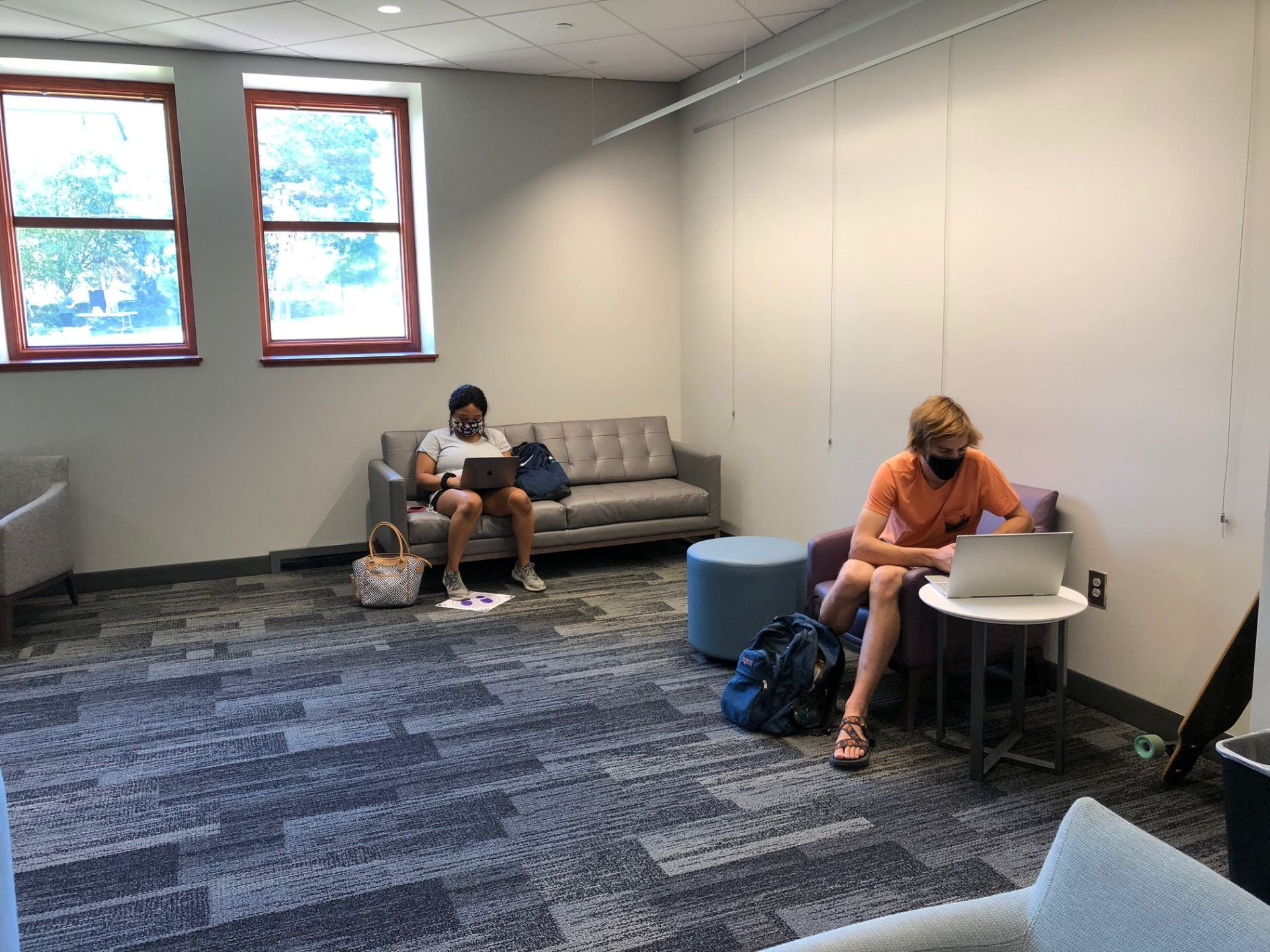 K-State students study on the first floor while wearing masks.