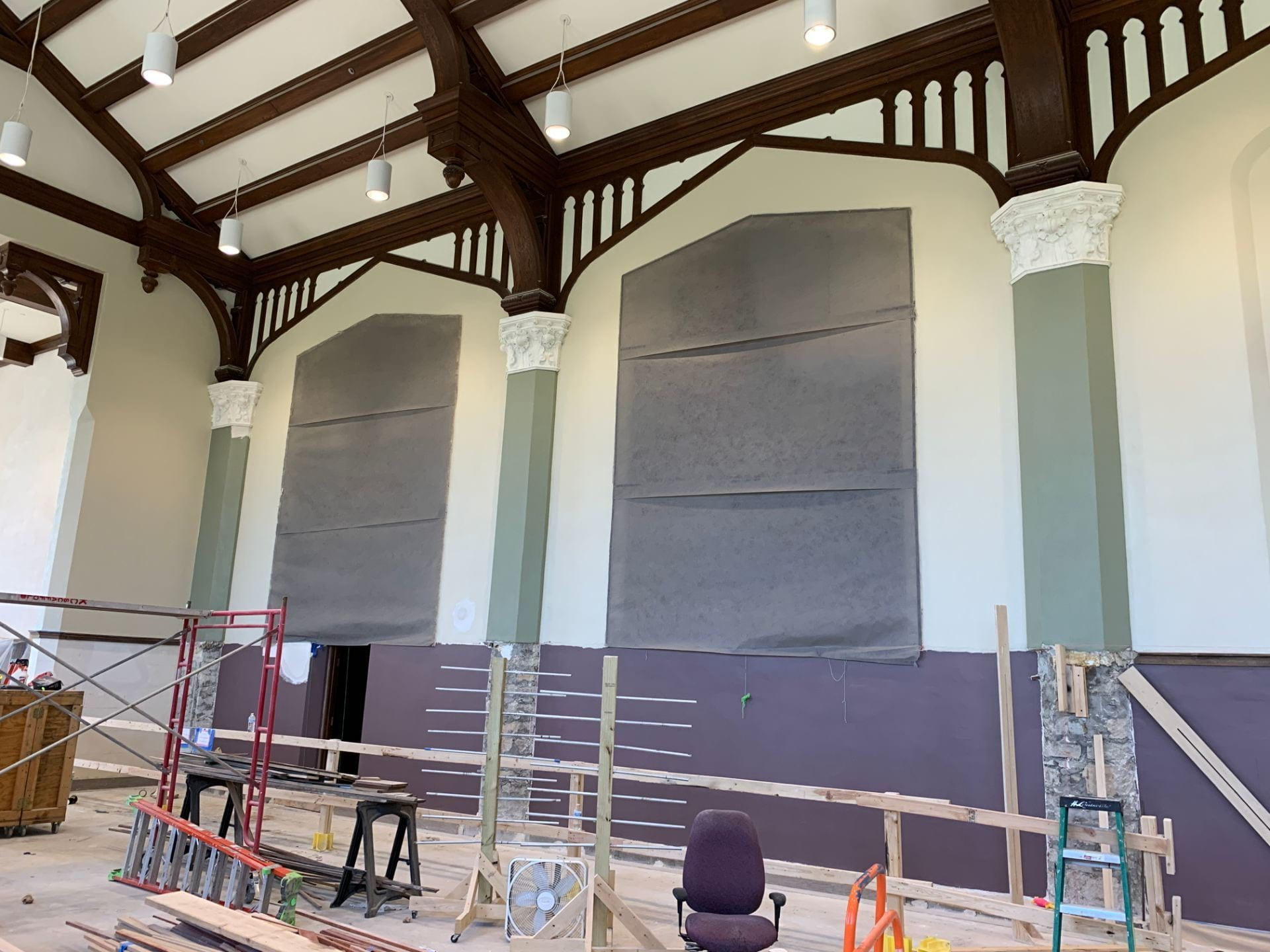 A picture of the walls surrounding the Great Room murals, painted purple, cream and green.