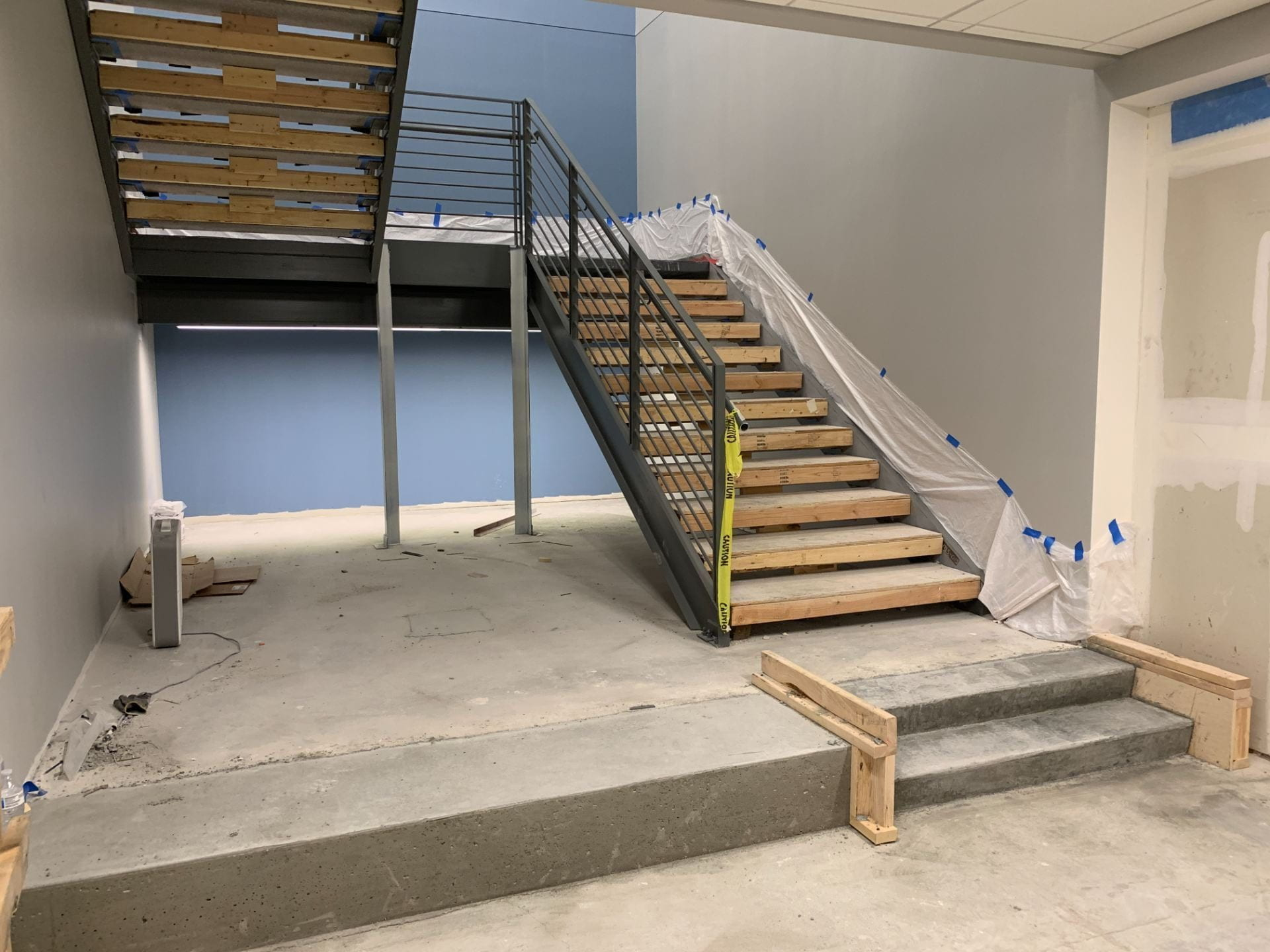 The stairs between the first and second floors of the Sunderland Foundation Innovation Lab are covered with wood temporarily.