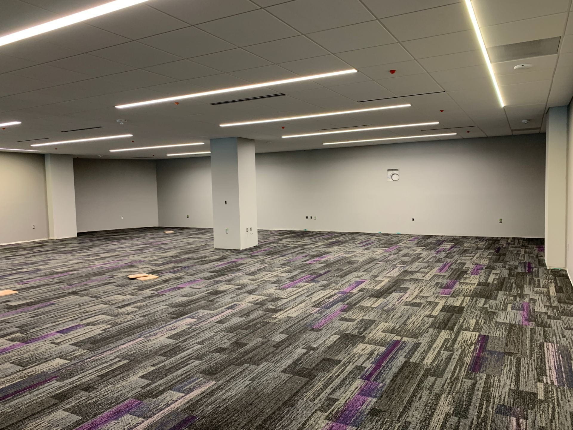 The inside of the Friends of the K-State Libraries Instruction Room, filled with carpet.