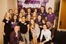 Anna with friends at a K-State event