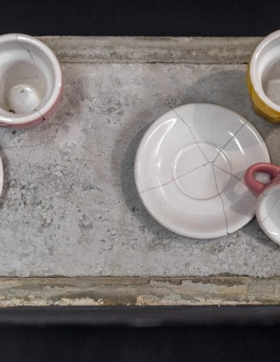 set fire to the Son (detail), 2019-2020, Hand broken IKEA children's tea set mended with the blood of OIF and OEF Marine veterans who are fathers, child's table, cement, dimensions variable