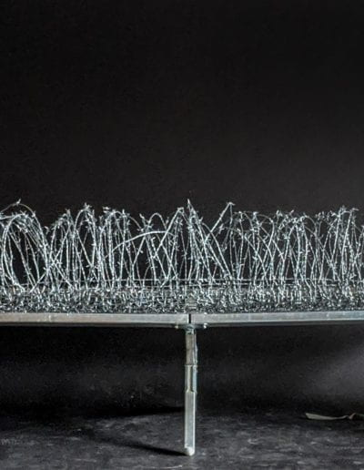 "manifest ii, 2020, Hand woven barbed wire, military cot, 80"" x 26"" x 17"""