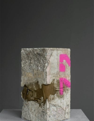 "steady on the line : inspector 72, 2020, Children's gas mask carrier, cement, concrete, spray paint, 5.5"" x 5.5"" x 11"""