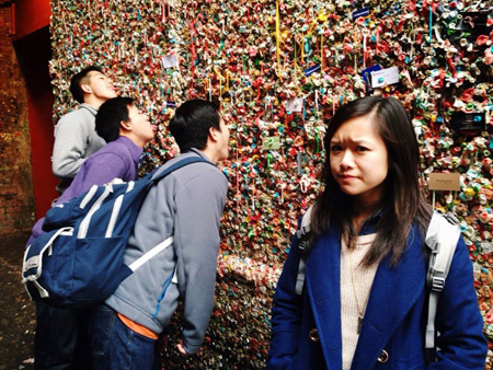 Three of the four team members making their mark at the infamous Gum Wall in downtown Seattle.