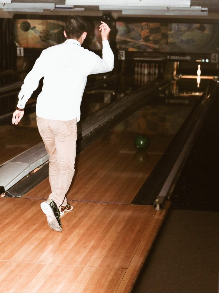 An MPA student bowls a strike at Texas Union Underground.