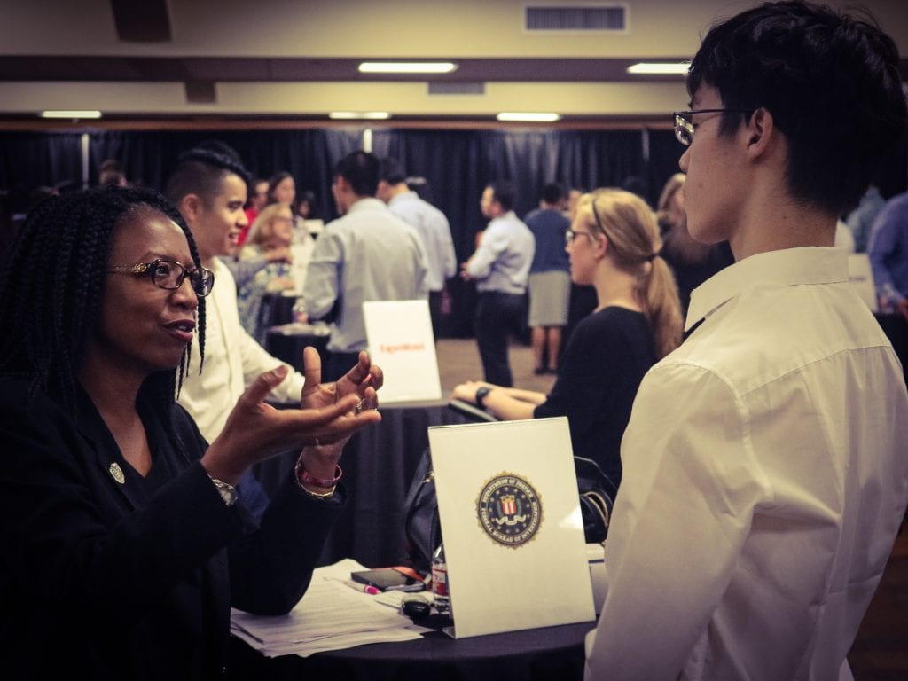 A representative from the FBI meets with a McCombs MPA student.