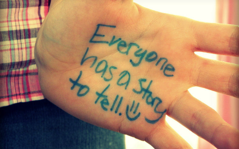 Person's Exposed Palm With This Note Written On It: Everyone Has A Story To Tell!
