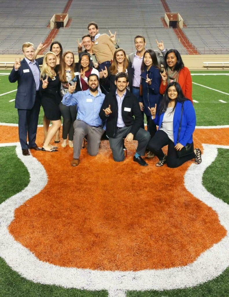 Current MBA Students on the football field for Texas Saturday. Hook 'Em!