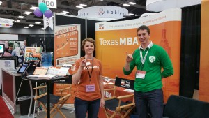 "Texas MBA staff & student show the ""Hook Em"" at the Texas MBA Booth at SXSW Trade Show"