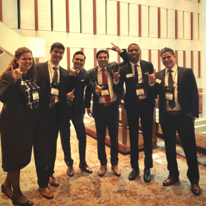 MBA students at CGSM, giving the hook 'em sign