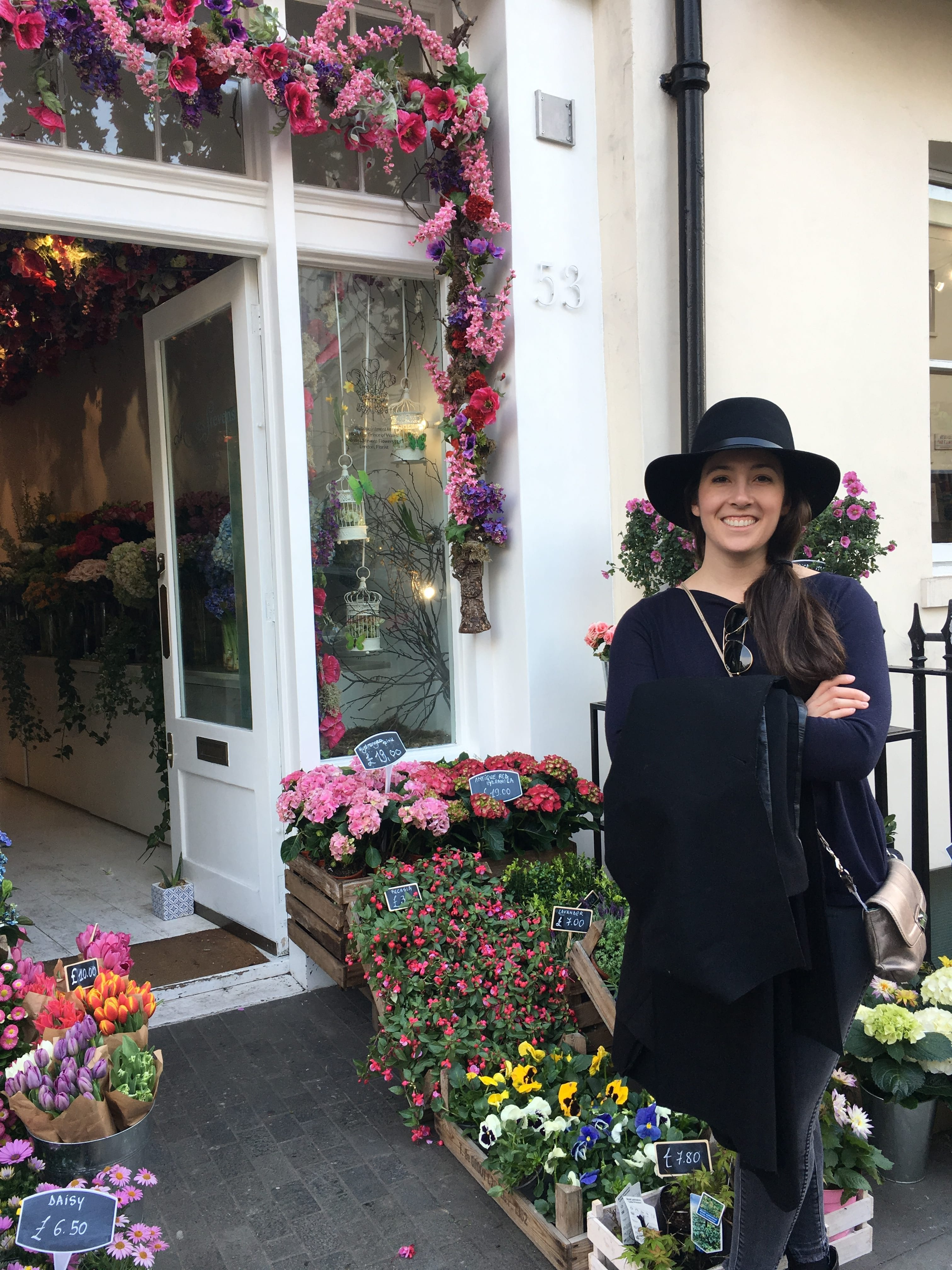 Stephanie outside a flower shop in Belgravia, London.