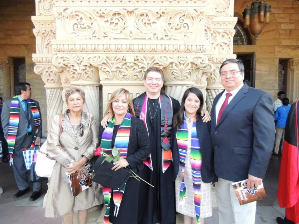 Mario and his family at his college graduation in 2013.
