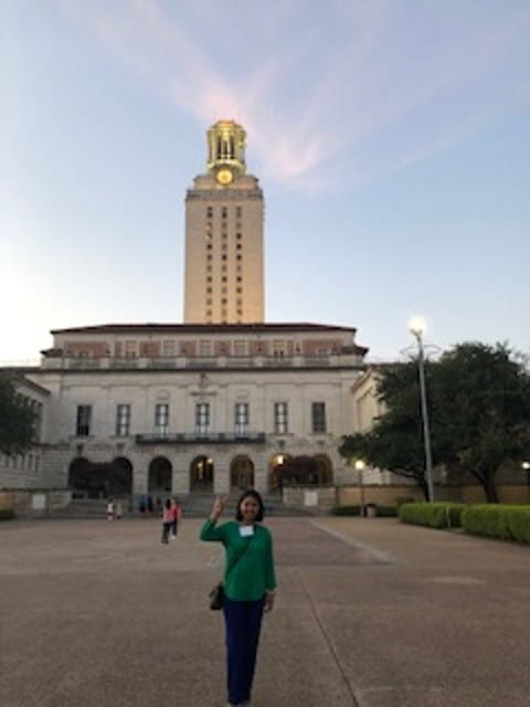 PHOTO: Elsa standing in front of the University of Texas tower.