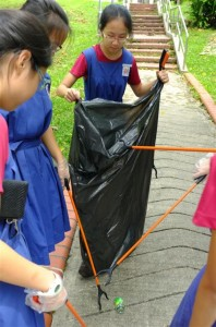 Students from CHIJ St. Nic's Girls' school picking up litter