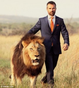 A poster showing Richardson walking beside a lion. Image source.