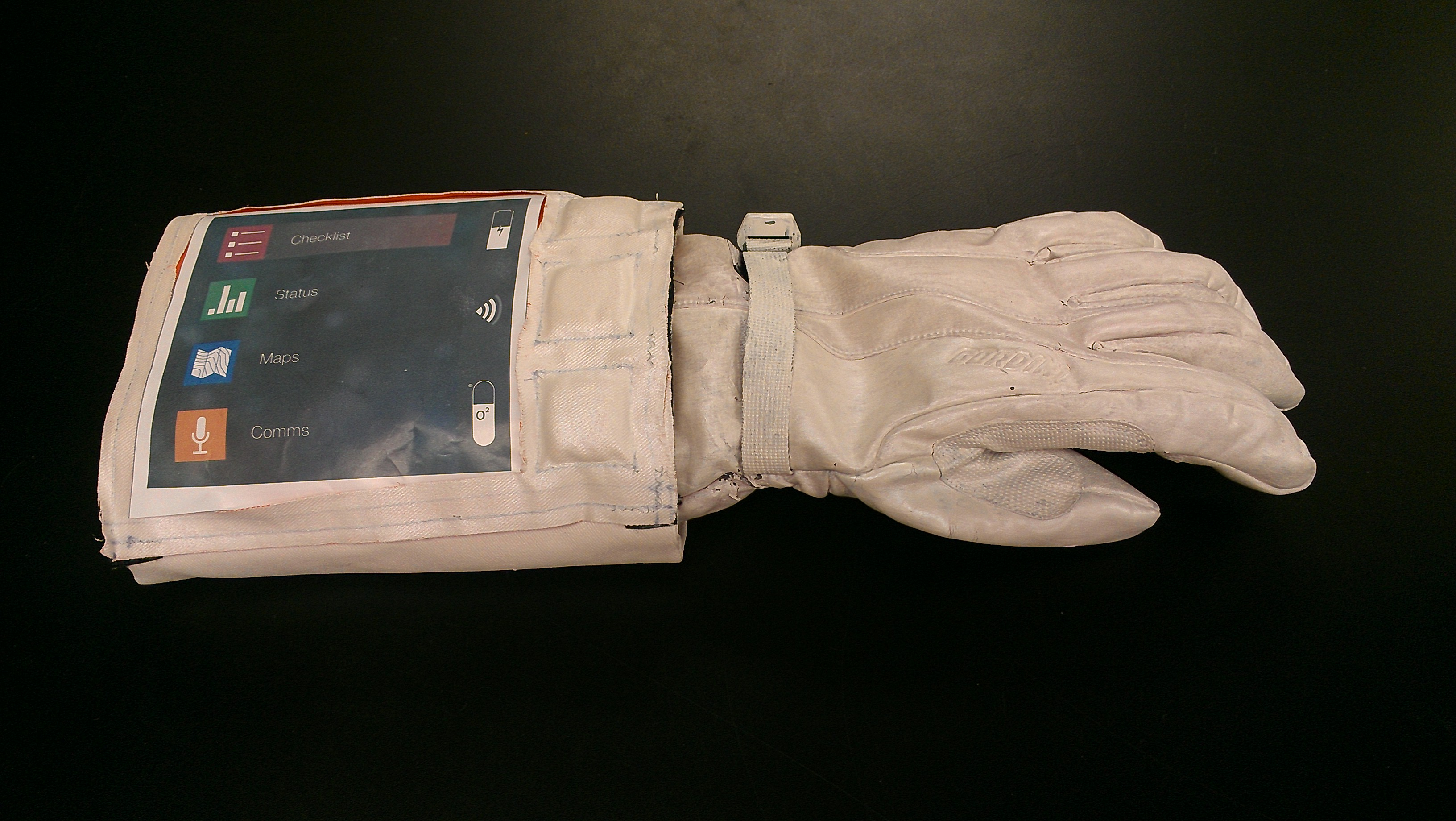 Prototype cuff checklist with soft fabric switches for for Space suit fabric