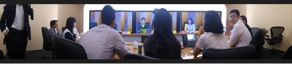 The picture above shows some of the participants trying out Cisco's TelePresence.