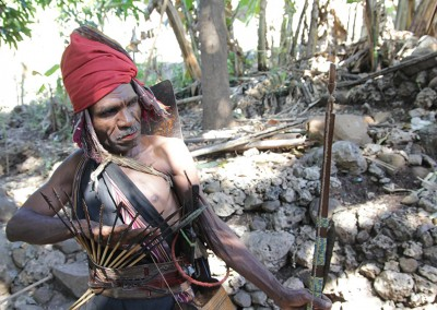 Apner Yetimau dons on traditional Abui gear with a hunting bow and 3 different types of arrows