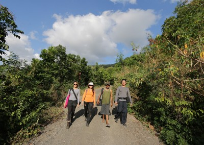 The film crew walks down the gravel road connecting Takpala and Takalelang. From left: Rachel Siao, Dang Mai Trang, Benediktus Delpada, Daniel Chong.