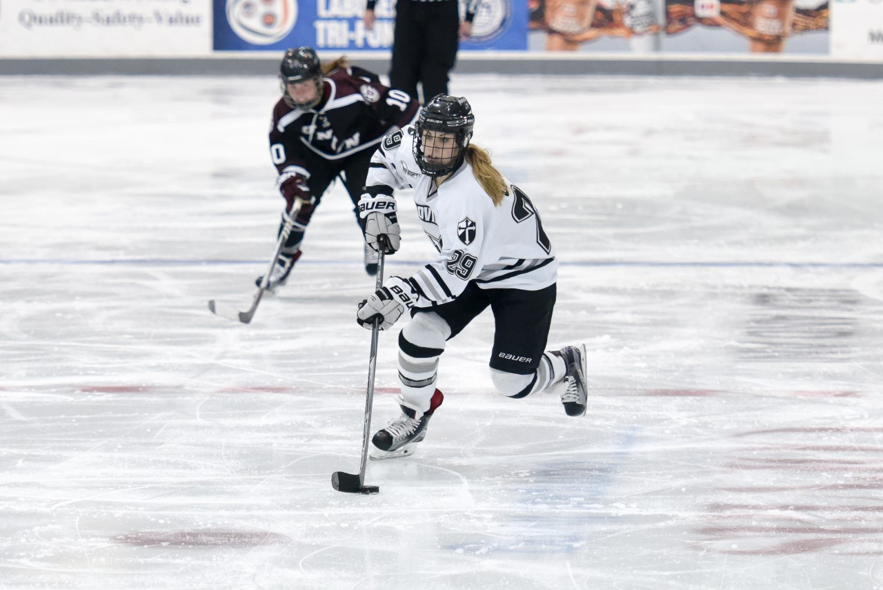 Cassidy Carels'17 brings the puck over center ice vs. Union.