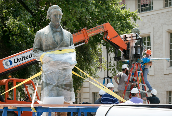 Three men removing the Jefferson Davis statue from UT-Austin's campus.