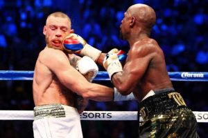 McGregor takes a hard hit from Mayweather.