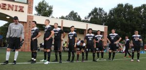Men's Soccer team lines up before the game starts.
