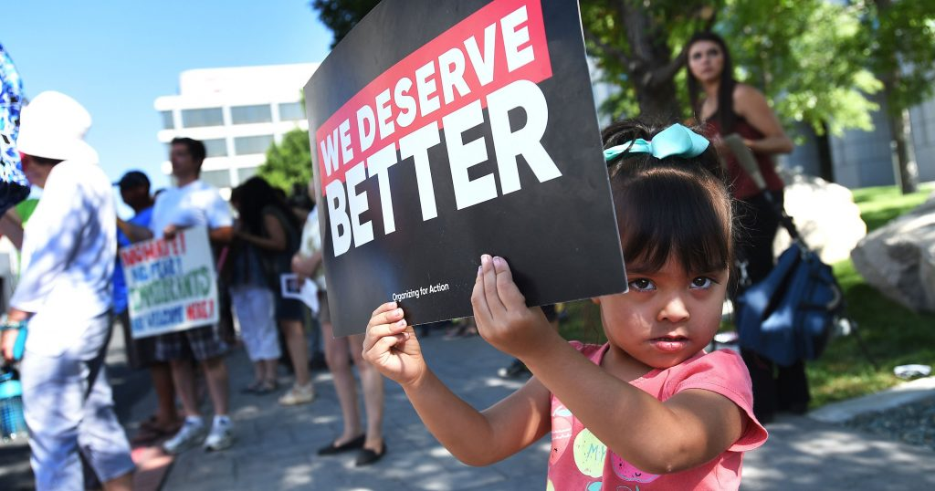 A young girl protests President Trump's move to end the DACA program
