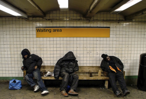 Homeless men in a subway station